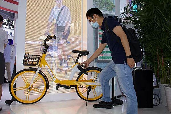 """数字人民币新玩法:""""碰一碰""""即可解锁单车"""